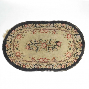 SOLD: Vintage oval hooked rug with floral motif on natural and black ground