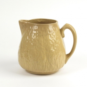 Antique yellow ware walnut pitcher by Brush McCoy Pottery