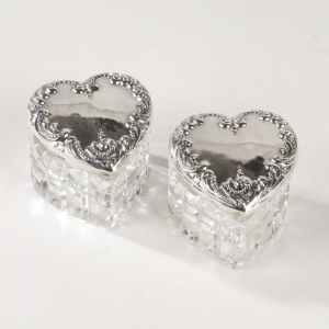 SOLD: Pair small heart shaped powder jars with sterling silver repousse lids