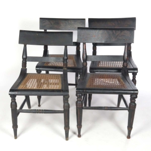 SOLD: 4 antique caned seat black painted side chairs with eagle motif