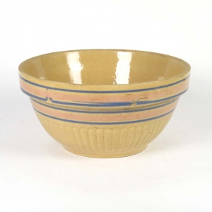 Antique yellow ware bowl with pink and blue stripes